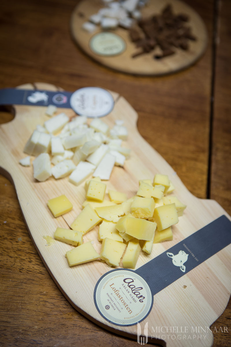 White and yellow cheese on a cutting board