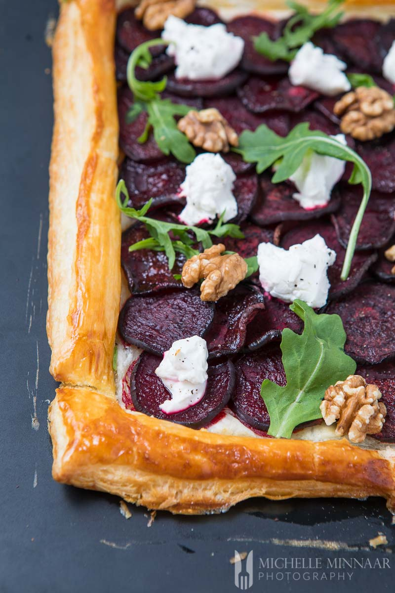 A close up of goat's cheese and beetroot tart
