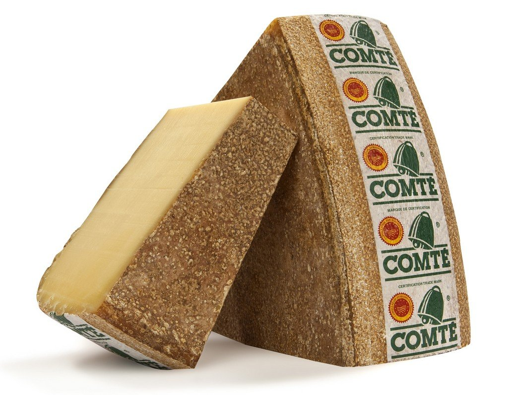 Two blocks of comte cheese standing up as a manchego cheese substitutes