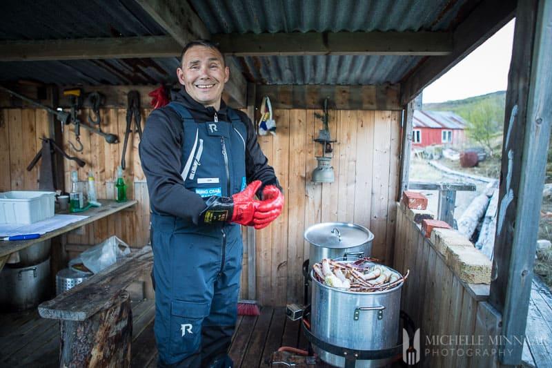 A smiling Fisherman preparing steamed crab legs