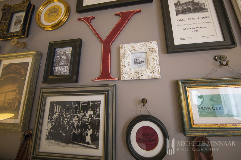 A wall of frames at Hotel Indigo