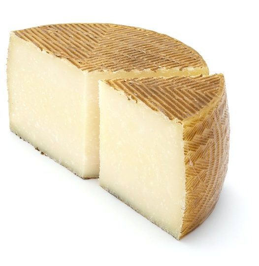 A large block of white manchego cheese