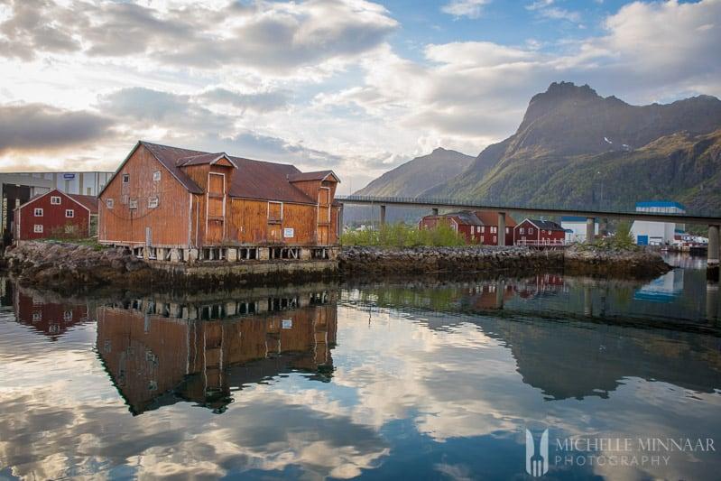 Older brown buildings on the coast of Norway