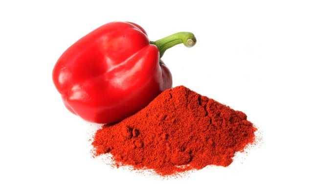 a pile of smoked paprika and a pepper