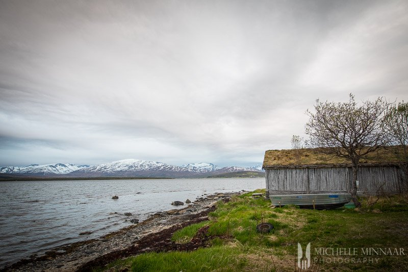 The coastline of Norway with a wooden house