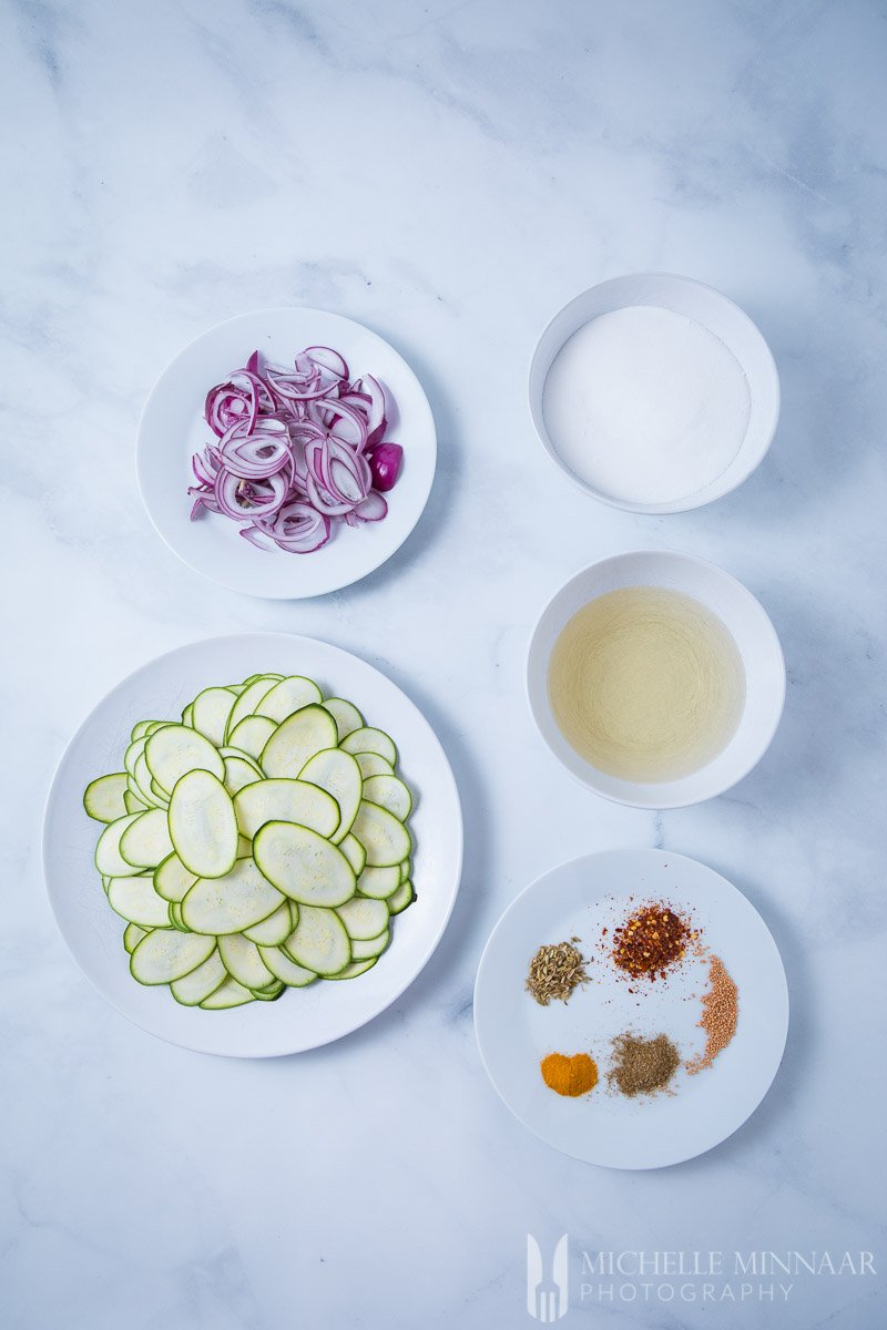 Prepared ingredients for Courgette Pickle: Sliced Onion Spices, Sliced Zucchini