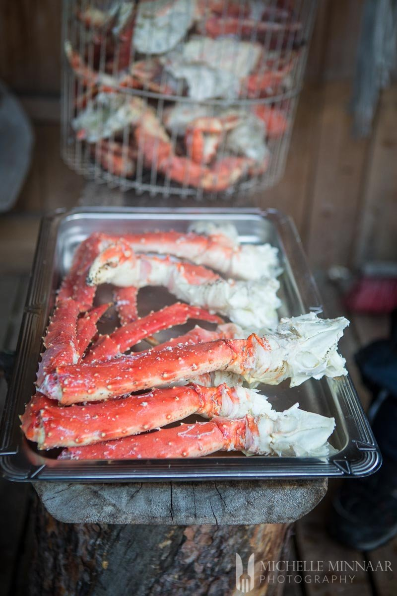 A close up view of the crab legs cooked in a sheet pan