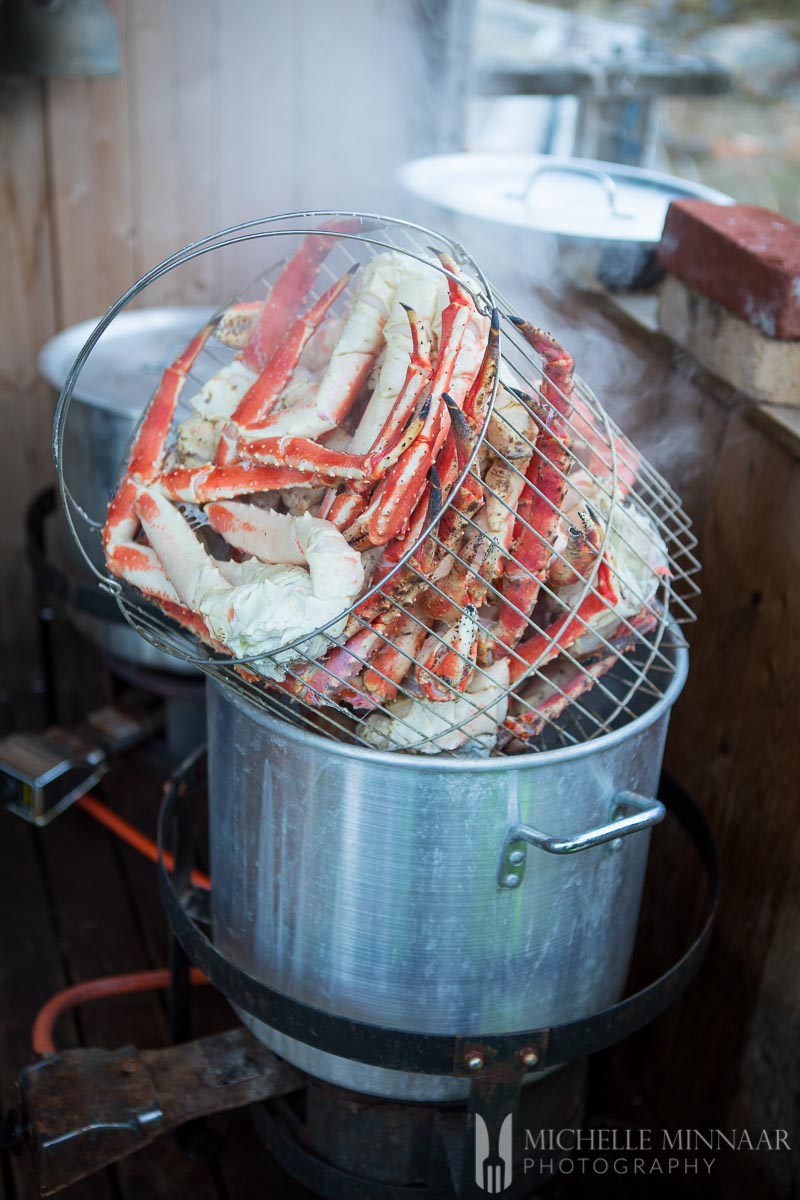A basket full of steamed crab legs