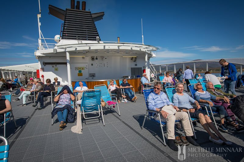 People on the sun bathing deck of the hurtigruten cruise