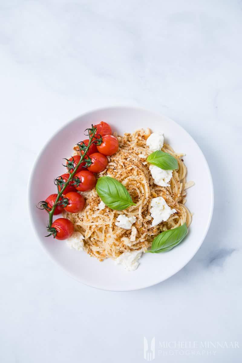 An aerial view of Pangritata Mozzarella Pasta Tomato