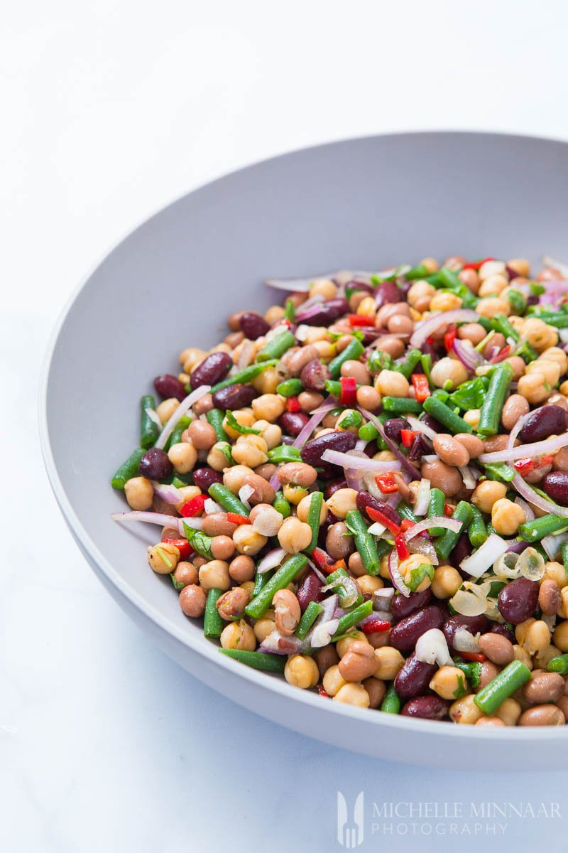 a bowl of 4 bean salad and onions