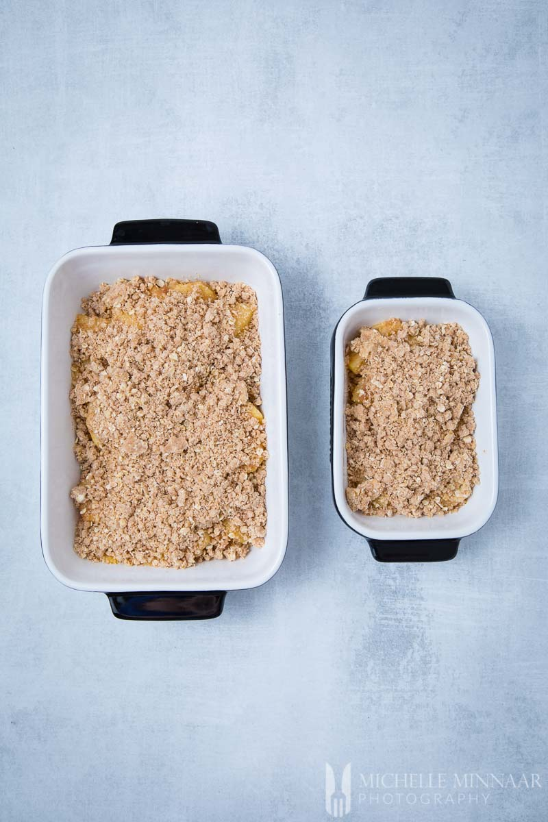 Raw apples with the cinnamon sugar crumble on top to make sugar free apple crisp