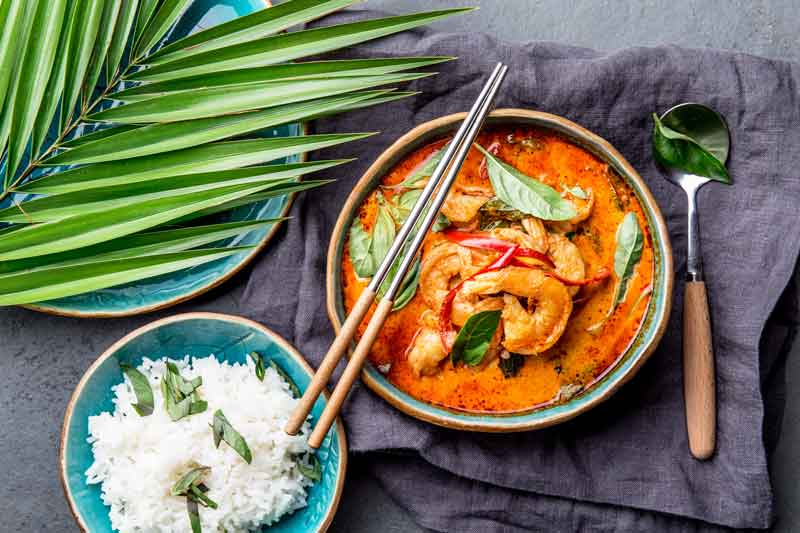 Full thai meal, white rice and red curry dish