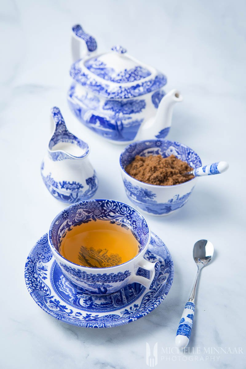 A cup of tea and blue and white tableware