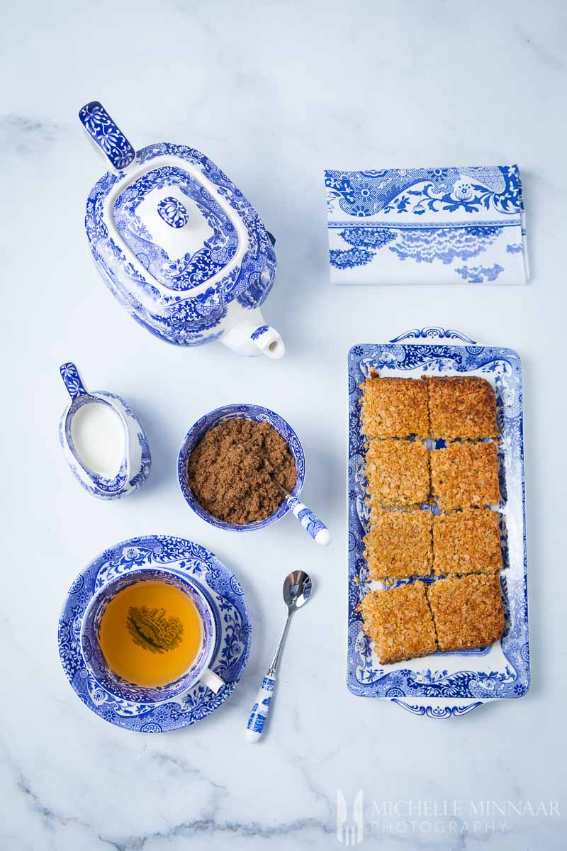 A plate of Sugar Free Flapjacks and a cup of tea and a teapot