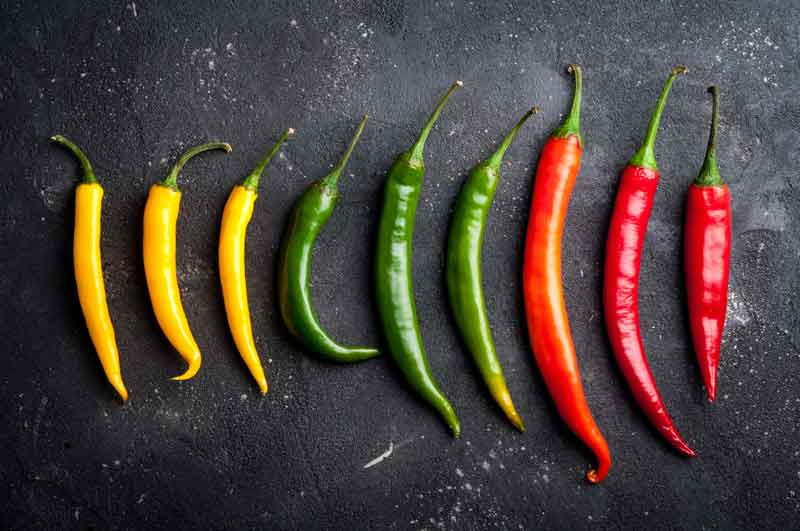 Skinny yellow, green and red chillies
