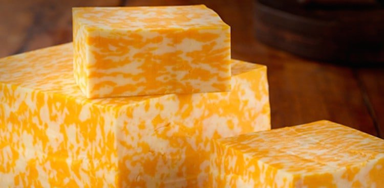 Blocks of orange and white cheese for a monterey jack cheese substitutes