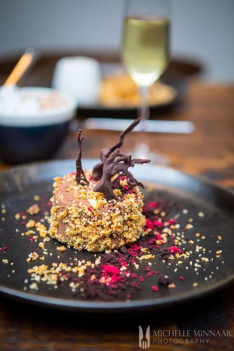 Hazelnut chocolate mousse with raspberry, hazelnut praline and chocolate crumble