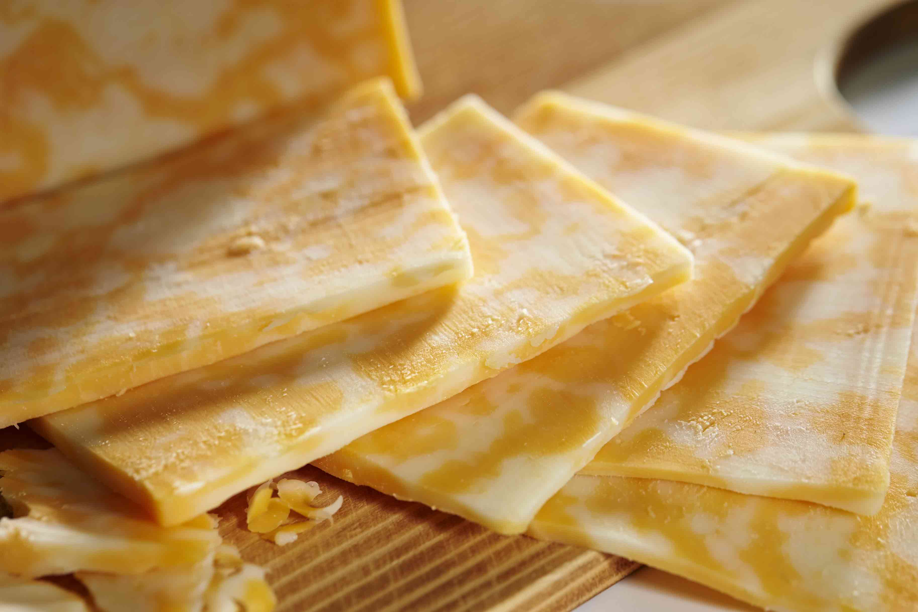 Yellow and white cheese slices