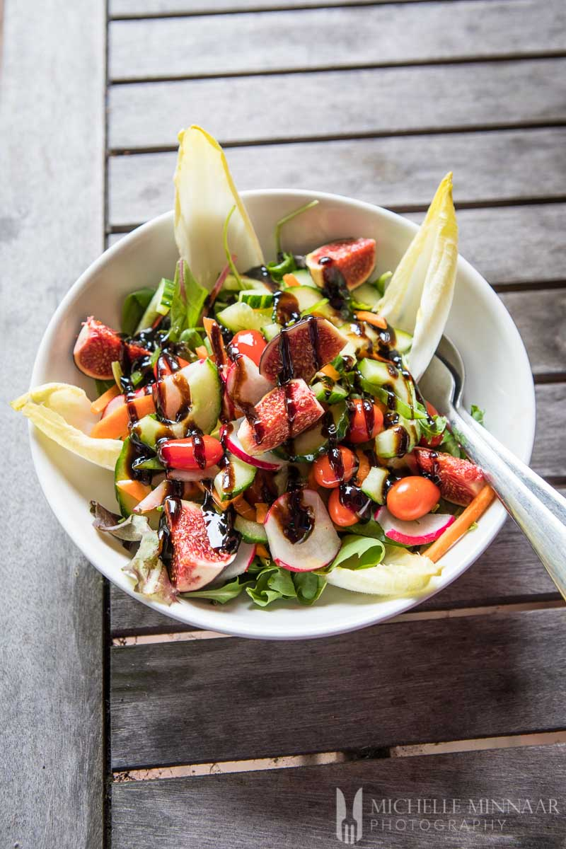 A fig and endive salad with a balsamic glaze
