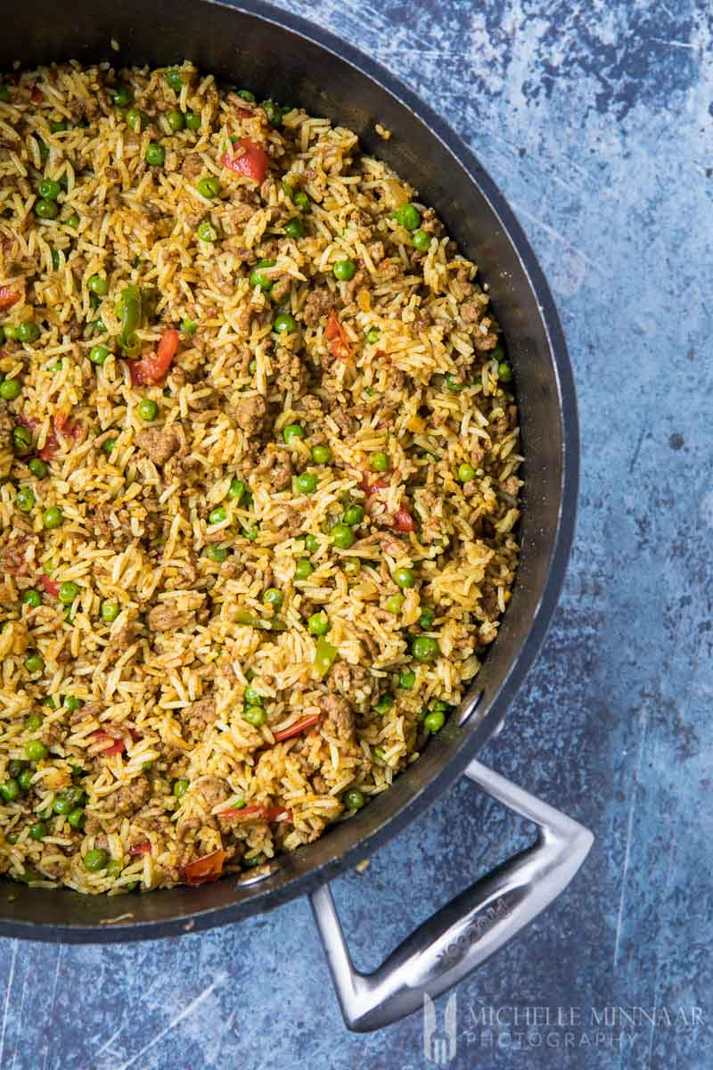 A close up of keema rice in a skillet