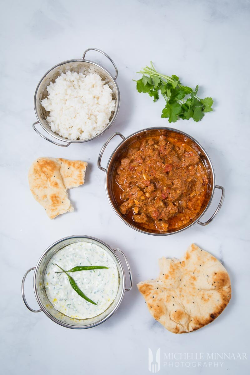 A complete Indian meal, Lamb madras, white rice, cacik dip and roti