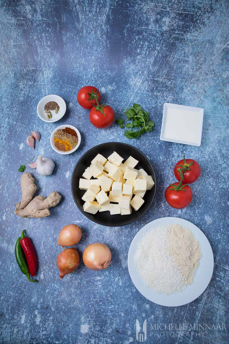 Ingredients for paneer korma: Cheese, spices, onions, tomato, Coconut, Almond, and Spices