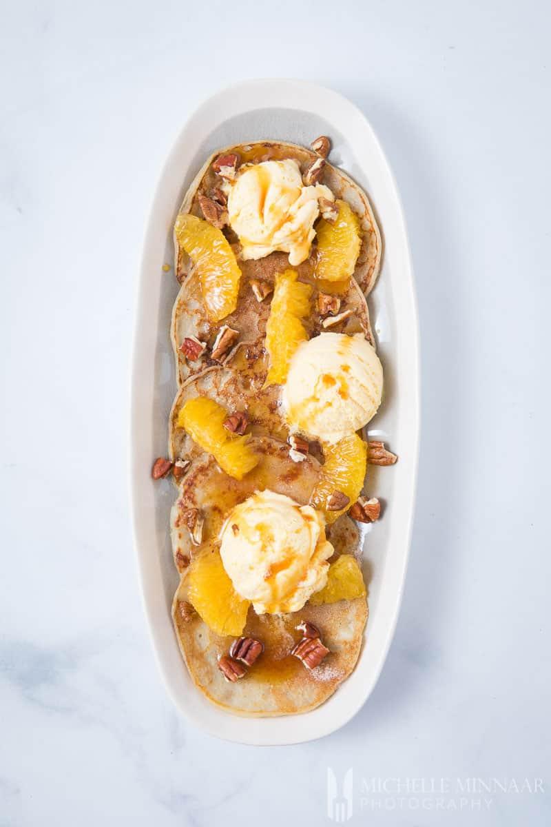 vegan sweet potato pancakes on a long plate