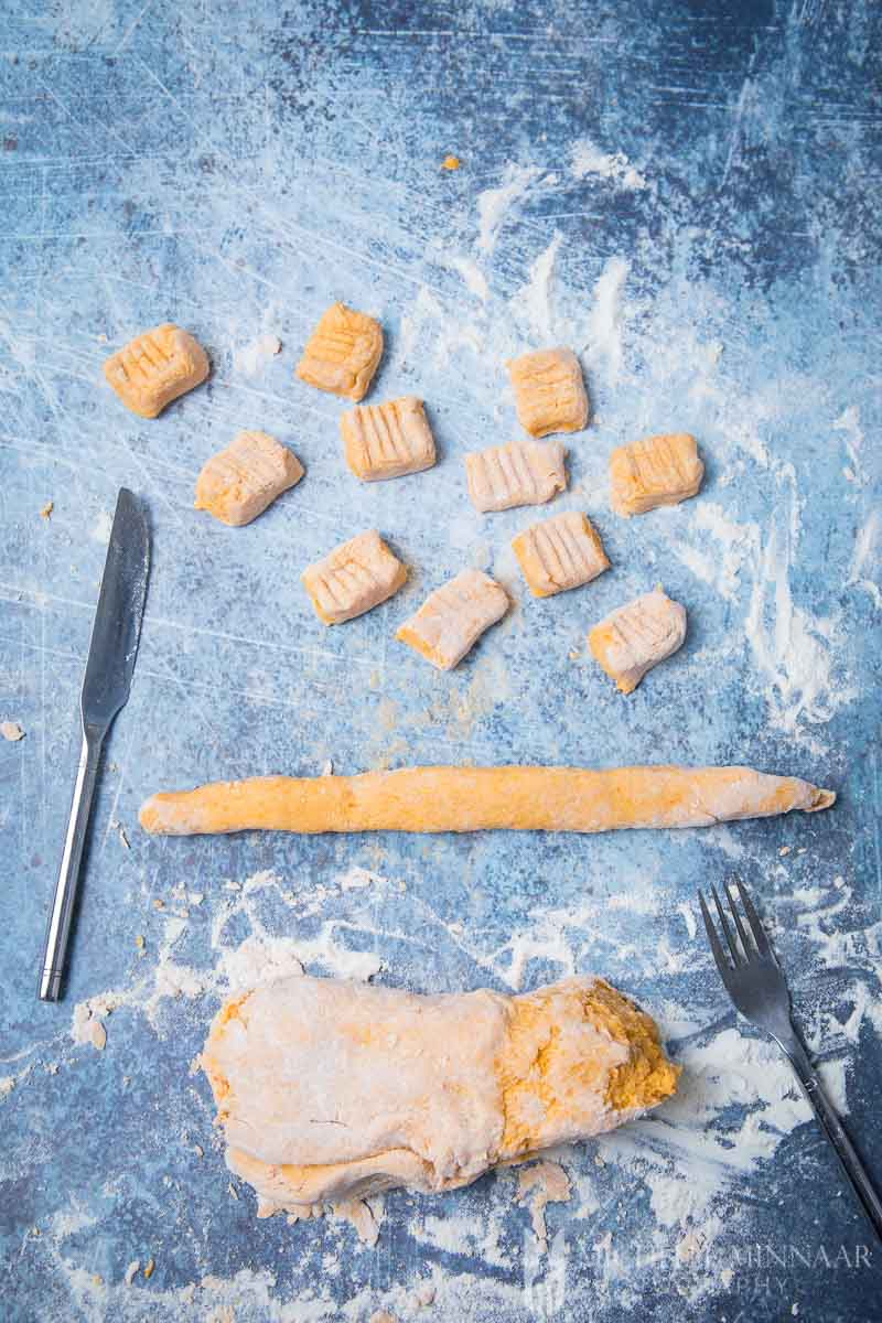 Raw orange pasta dough on a counter