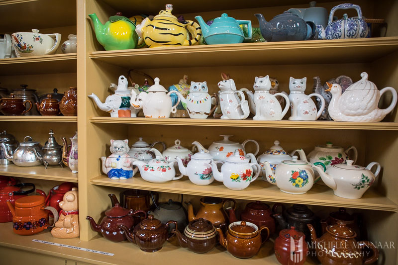 A wall of teapots in different shapes and sizes