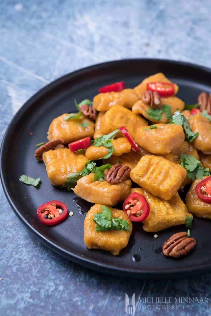 A close up of vegan sweet potato gnocchi