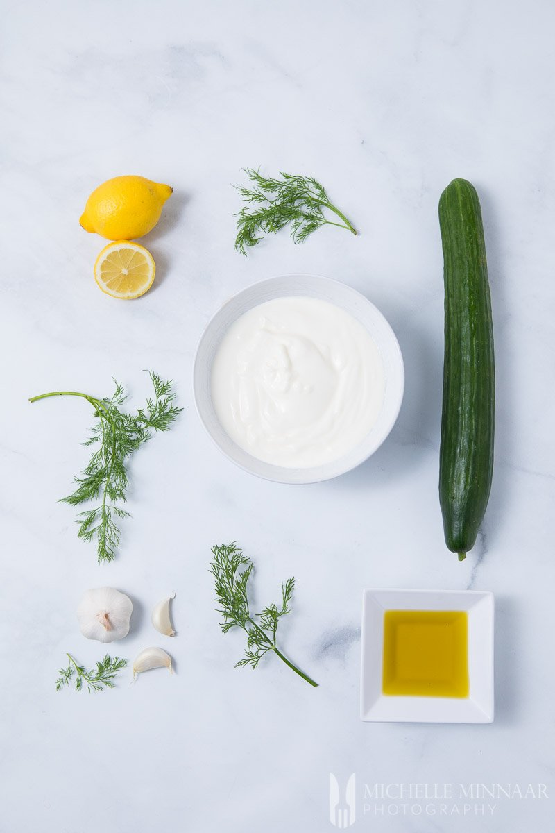 Ingredients to make cacik : cucumber, yogurt, lemons, dills, garlic