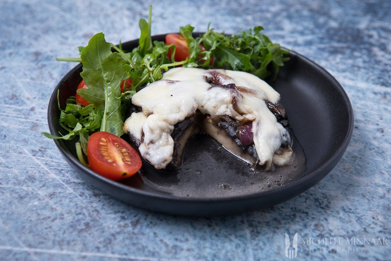 Mushrooms covered in white cheese Meal
