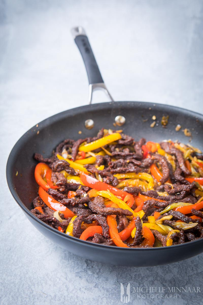 crispy chilli beef in a skillet