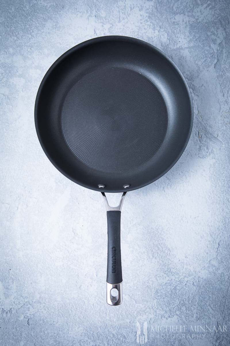 A black Circulon skillet with a black handle