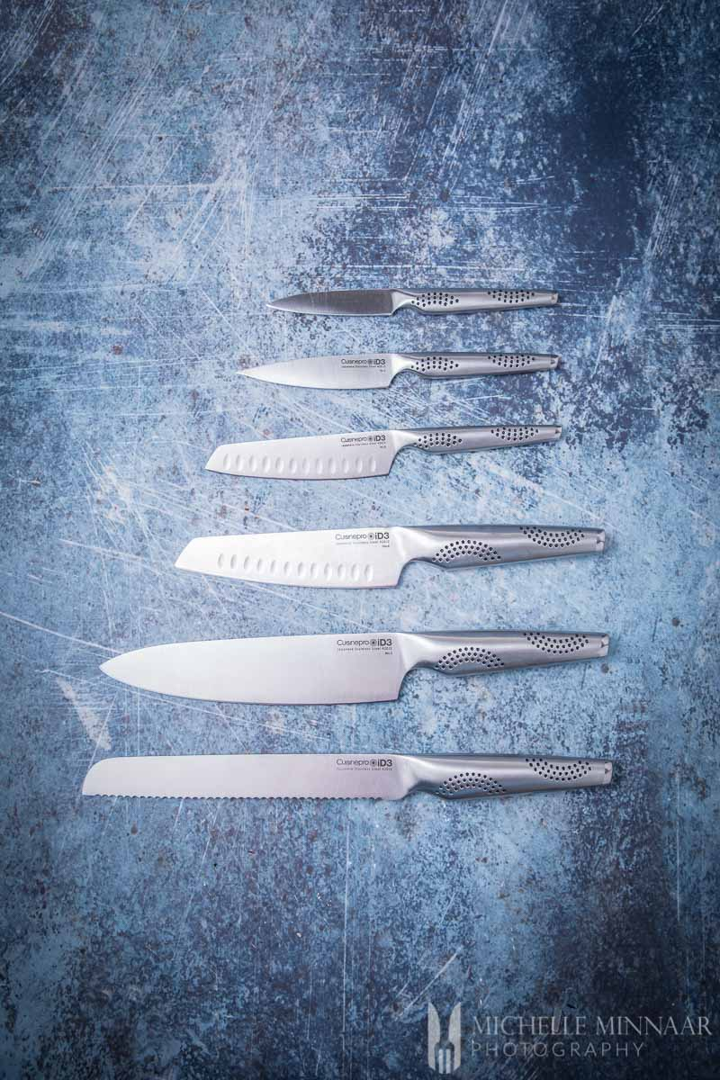 a set of 6 silver knives