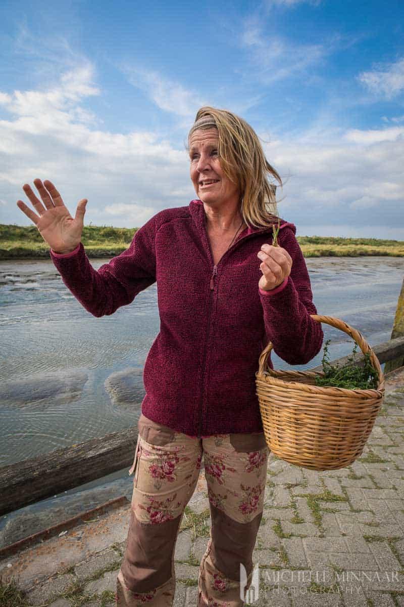 A woman holding a wicker basket