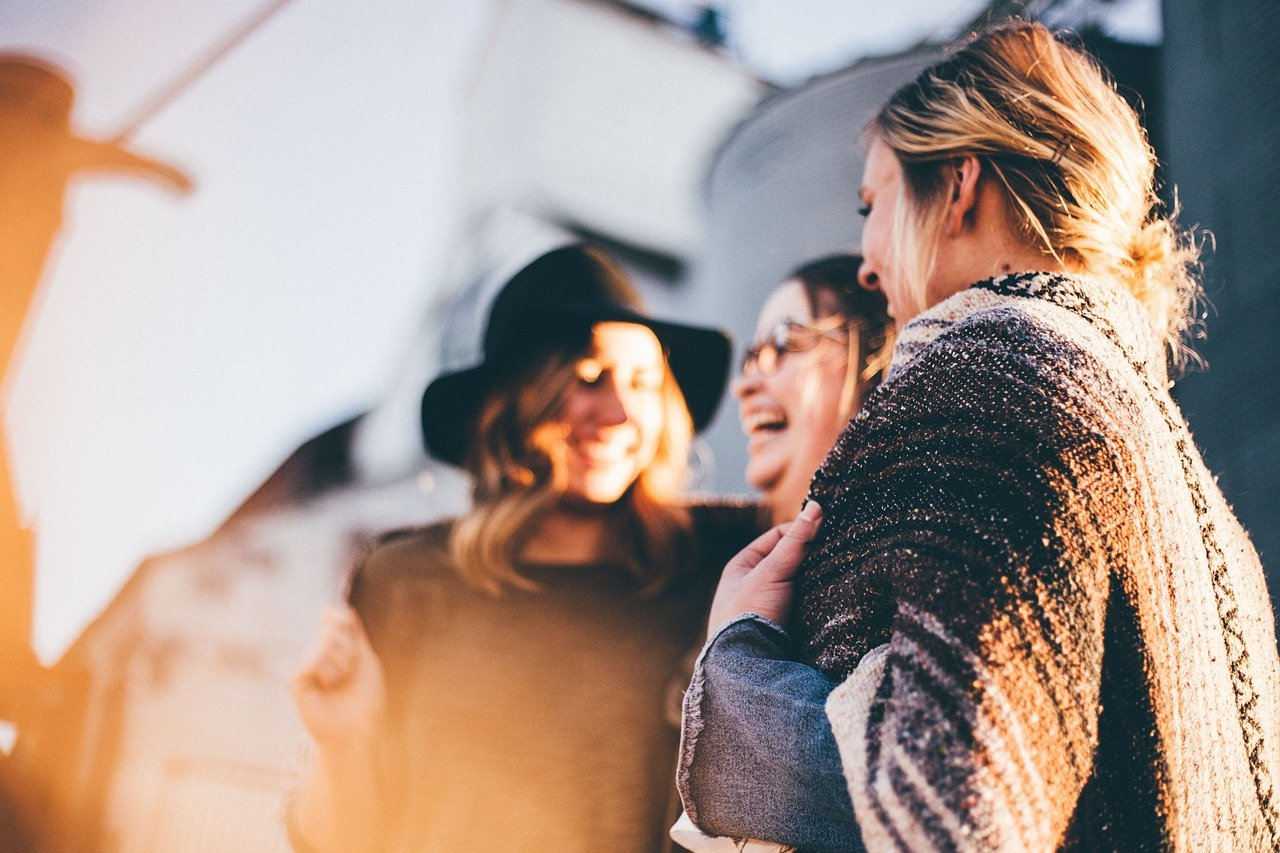 A group of woman laughing about seasickness