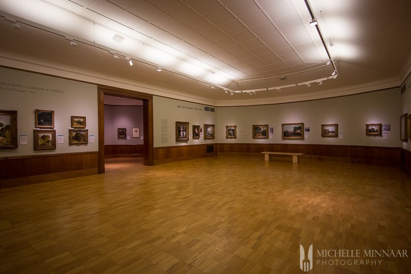Art Collection in a room with a wooden floor
