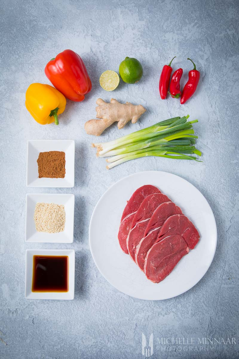Ingredients for crispy chilli beef: Ginger Onion Soy Spices Steak Pepper Slime