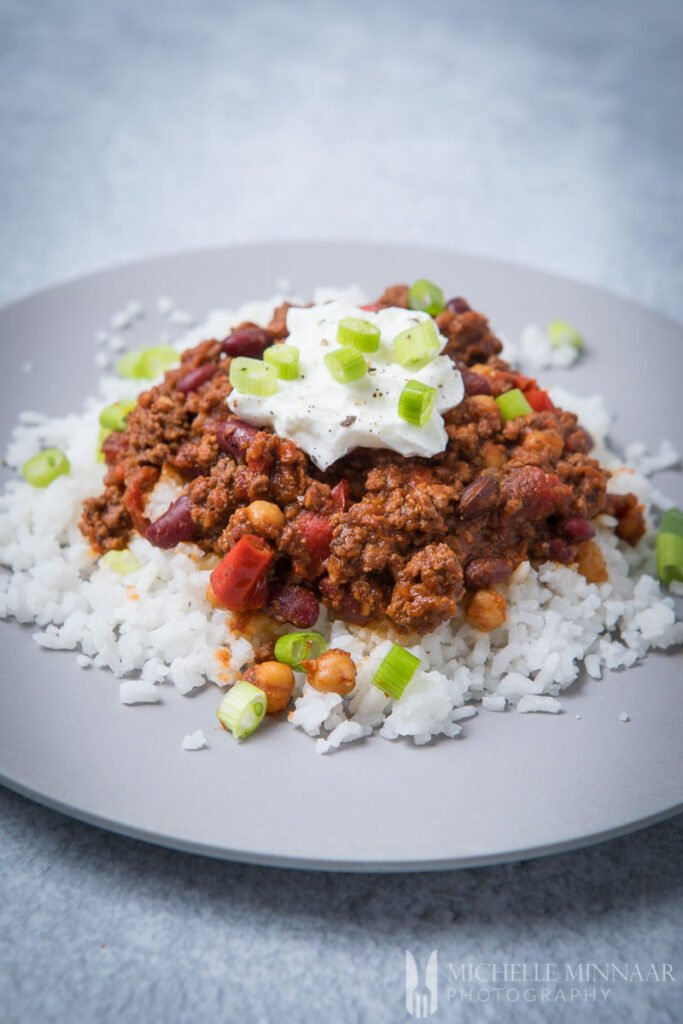 Venson chili on top of a bed of white rice