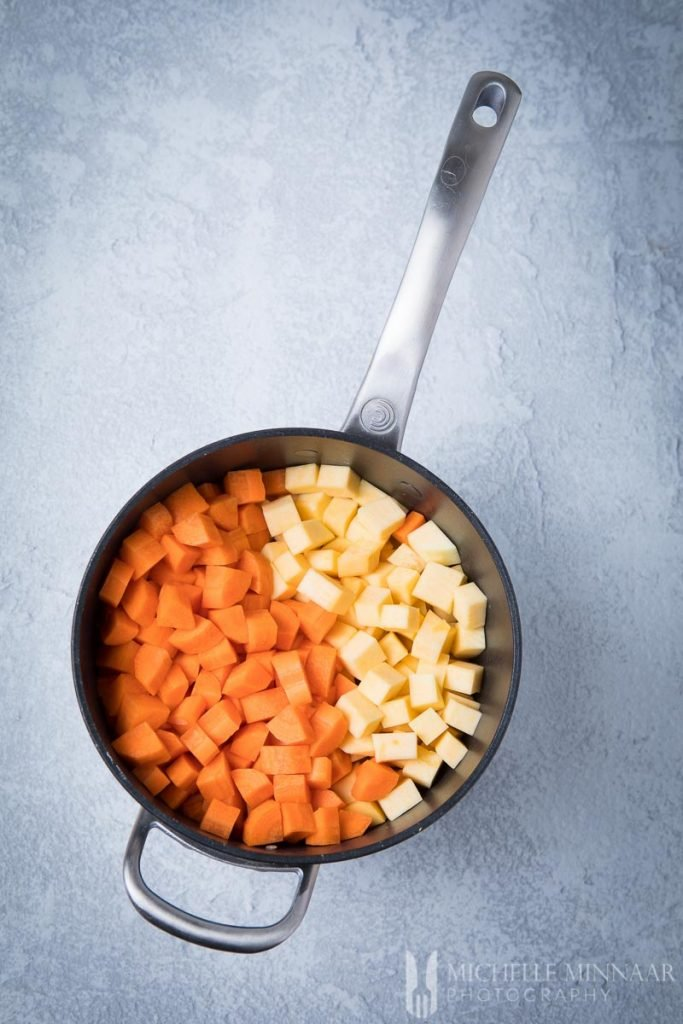 Cubes of carrot and swede in a stockpot