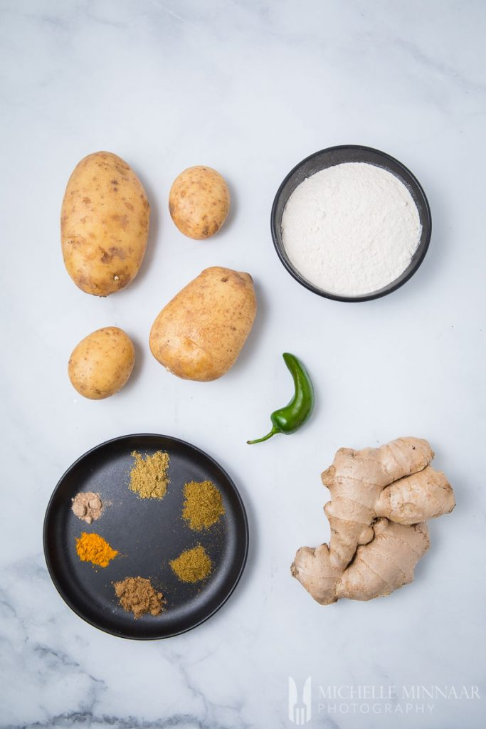 Ingredients for aloo ki kachori: Ginger Chilli Potato Flour Spices