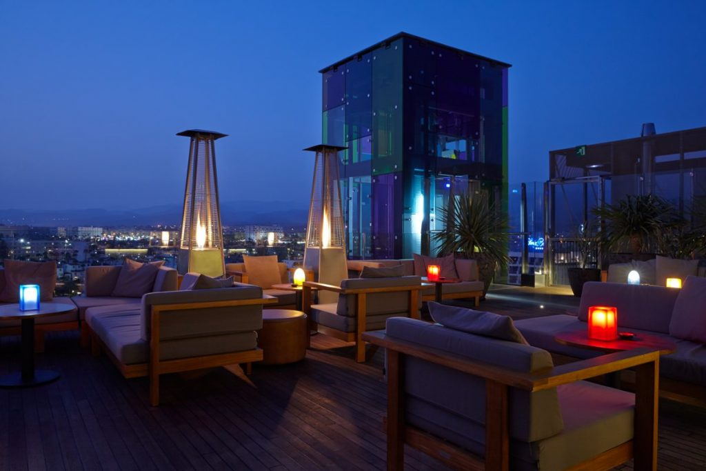 A fancy rooftop bar at nighttime