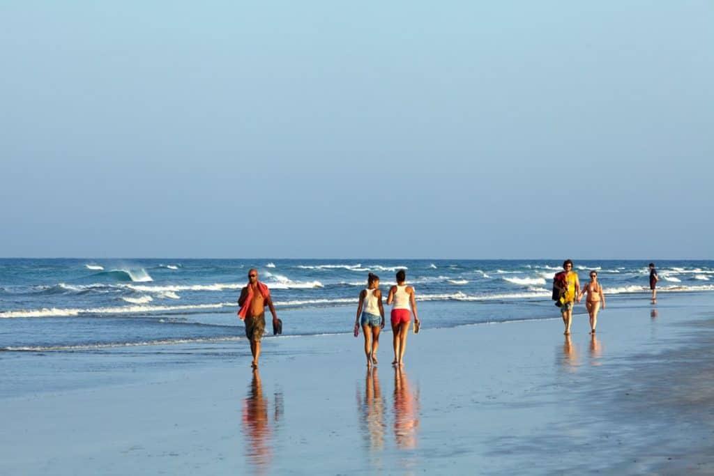 People walking on a beach in spain