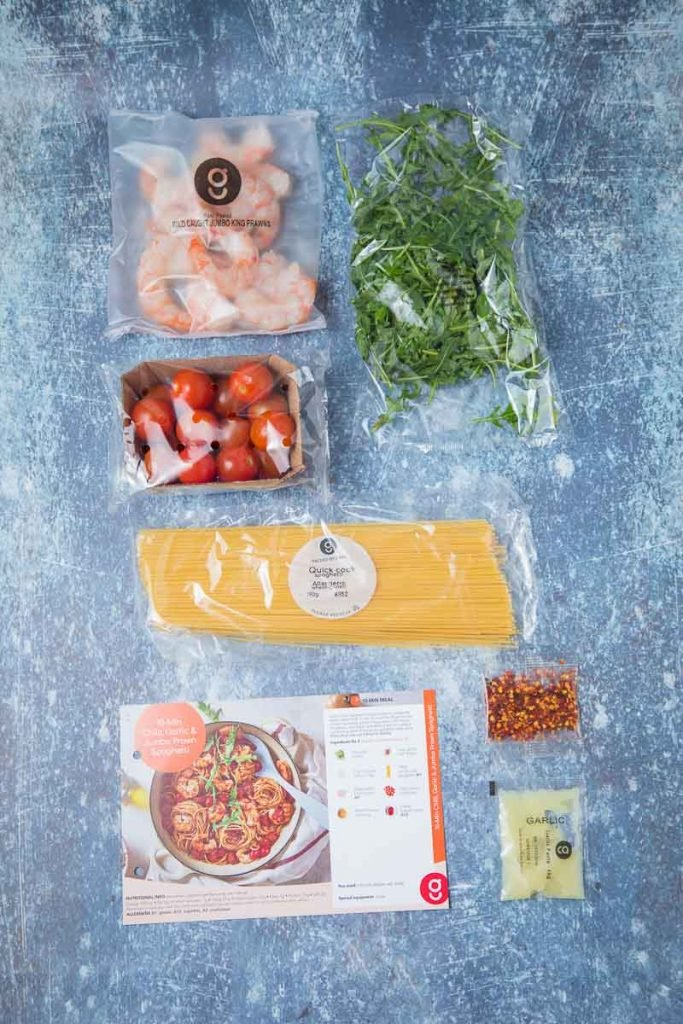 Ingredients to make chilli prawn pasta on a counter