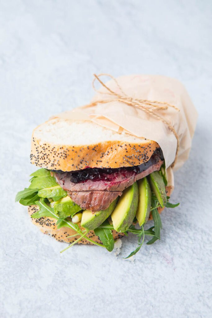 A lamb sandwich, lamb and avocado in bread