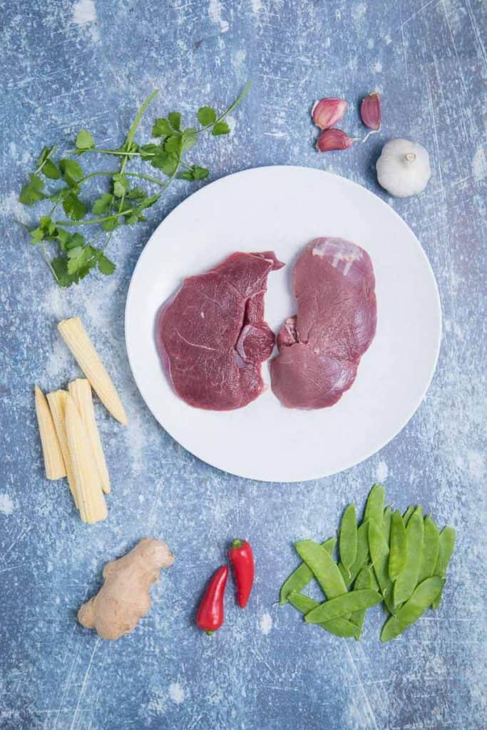 Ingredients for venison stir fry, raw venison, corn, snap peas