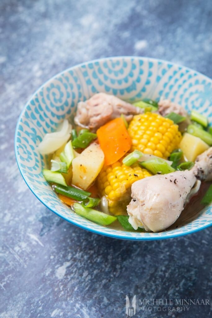 A bowl of ABC soup - chicken, corn, carrots
