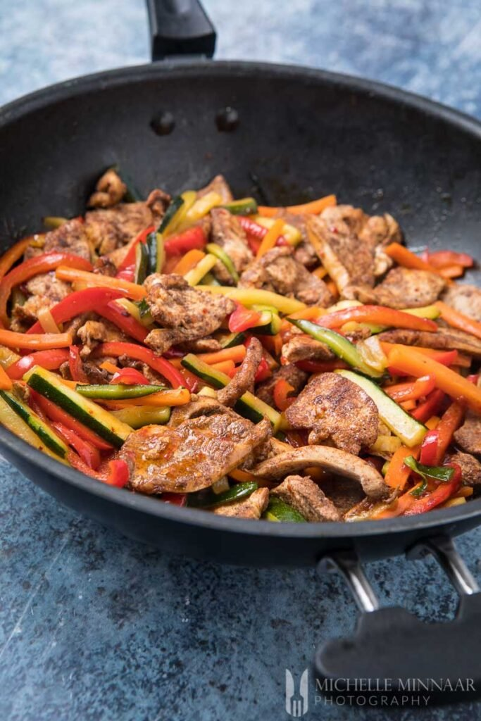 sweet chili chicken stir fry in a pan